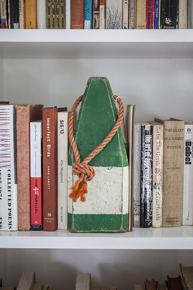 Modern Bookshelf - A buoy figurine on a bookshelf