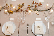 An overhead of a contemporary tablescape with seasonal decor.