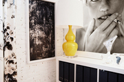 A bright yellow lamp contrasted with black-and-white artwork