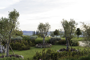 Lush gardens with views of the Tuscan countryside