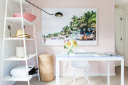A contemporary workspace with a pink wall.