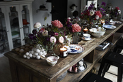 Fine china and floral arrangements line a festive table