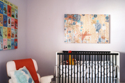 A nursery filled with art and iconic furniture