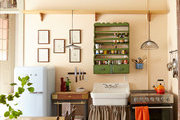 A kitchen in New Orleans' French Quarter  features vintage touches, including a Smeg refrigerator and freestanding appliances