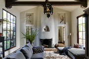 Exposed ceiling beams  in rustic living room