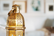 A gold lantern in a neutral living space
