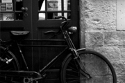 A bicycle propped against a door