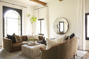 Emily Current's modern living room features two couches and an ottoman.