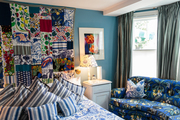 A mosaic of fabric replaces a traditional headboard