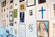 A gallery wall of framed artwork