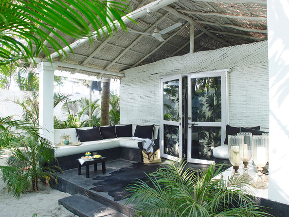 Porch - The front porch of fashion designer Laurence Dolige's tropical beach house