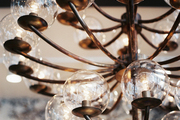 A vintage glass-and-brass chandelier
