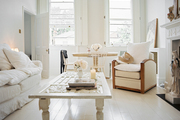 A white couch and coffee table in an open living-dining space