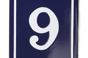An enamel house number is reminiscent of the addresses on the rues of Paris