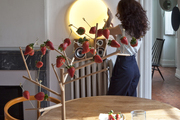 A strawberry server tree on a rustic kitchen table.