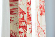 Sunbeams through red and white toile drapes
