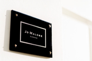 A sign on the exterior of Jo Malone London's global headquarters