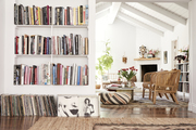 A bright white living space with built-in bookshelves.