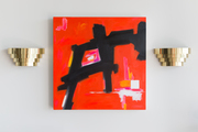 A detail of a pair of mid-century modern brass lights around an abstract red painting.
