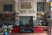 Pops of cheery red surface throughout the home, including in the kitchen.