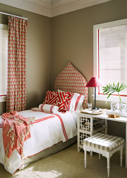 Roman Shades - A guest bedroom with coordinating block-printed upholstery and window treatments