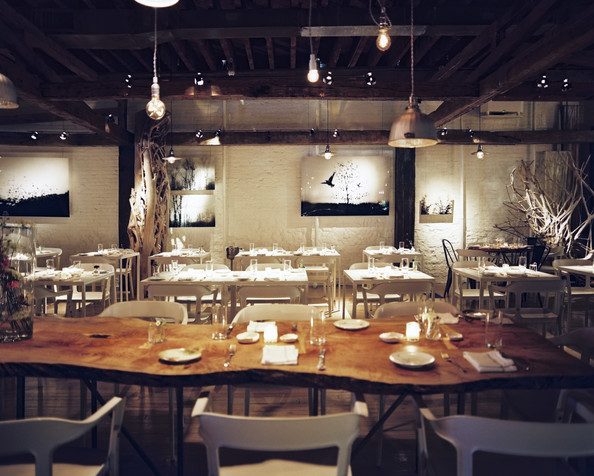Dining table and white chairs at abc kitchen details white rustic