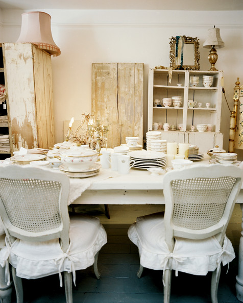 Rustic Shelf - White cane-back chairs surrounding a white dining table ...