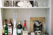 White shelves filled with bar essentials and glassware