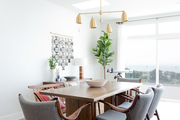 A contemporary dining space with beachy vibes.