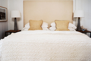 White paneled walls in a neutral bedroom