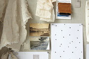 Fabric swatches pinned to a bulletin board