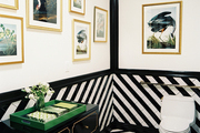 Black-and-white tile paired with a Dorothy Draper-inspired cabinet