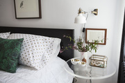 Polka dot pillowcases and a green throw pillow on top of crisp white linens