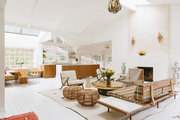 A white and brown living space with gold accents and vintage decor.
