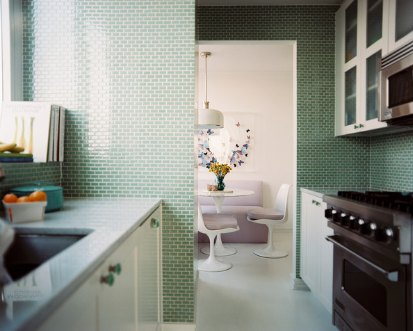 kitchen green tile and white cabinets in a kitchen details green