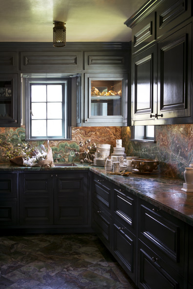Specialty Room - Marble countertops and gray cabinets in a butler's pantry