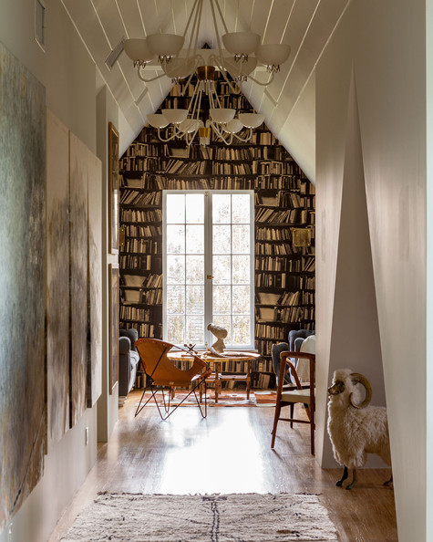 Specialty Room - A reading nook with the feel of a library thanks to trompe l'oeil wallpaper