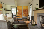 An antique sleigh bed in front of a fireplace in a living space