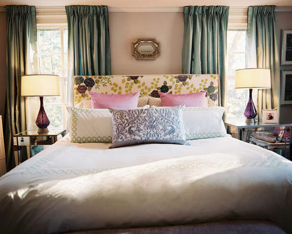 Traditional - Green curtains and an upholstered floral headboard with white bedding