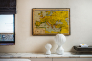 A map of Europe and sleek light fixtures in a bedroom