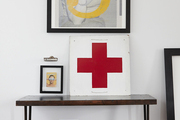 A rare moment of look-at-me color: a vintage Red Cross sign from the Wexford General Store under a James Dean print.