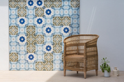 A tiled wall outdoors with a rattan chair.