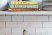 A detail of a kitchen shelf with cookbooks.