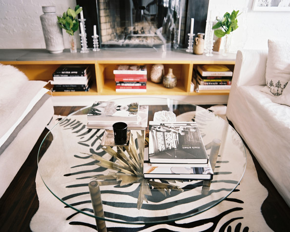 Urban A Glass Coffee Table Atop A Zebra Print Rug In A Neutral Living Space