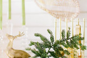 A festive tableau with a Heath Cereamics bud vase and gold accents.