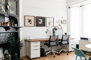 A contemporary workspace with white and black walls.
