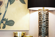 A grouping of brass bowls on an Art Deco-inspired sideboard