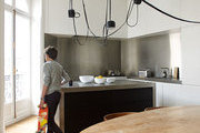 A kitchen with Aim pendant lamps, designed by Ronan & Erwan Bouroullec for Flos.