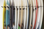 Surfboards stacked atop a serape-style blanket