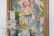 A colorful painting and a trio of glass candlesticks